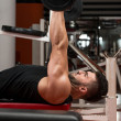 Muscular Man Exercising Triceps With Barbell — Stock Photo