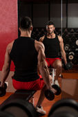 Muscular Man Exercising Biceps With Dumbbells — Stock Photo