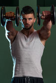 Muscular Men Exercising Shoulder With Dumbbells — Stock Photo