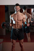 Men In Gym Exercising With Dumbbells — Stock Photo