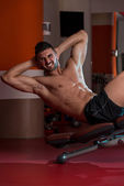 Exercising Abdominals In Fitness Club — Stock Photo