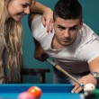 Young Couple Plays Billiards — Stock Photo #40692259