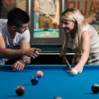 Man Teaching Woman How To Play Pool — Stock Photo