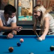 Man Teaching Woman How To Play Pool — Stock Photo #40694667