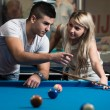 Man Teaching Woman How To Play Pool — Stock Photo #40694951