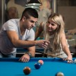 Man Teaching Woman How To Play Pool — Stock Photo #40694963