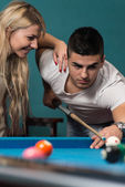 Young Couple Plays Billiards — Stock Photo