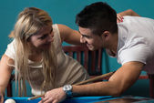 Boy And Girl Flirting On A Pool Game — Stock Photo