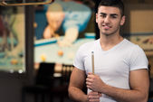Portrait Of A Young Male Model Playing Billiards — Stock Photo