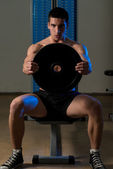 Exercise For Shoulders Front Plate Raise — Photo