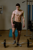 Teenage Boy Standing By The Barbell — Foto Stock