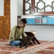 Young Muslim Guy Reading The Koran — Stock Photo