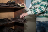 Young Man Takes Slippers To Use Them — Stock Photo