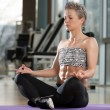 Woman Meditating In A Health Club Doing Yoga — Stock Photo