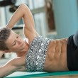 Young Woman Doing Sit-Ups — Stock Photo