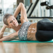 Smiling Woman Doing Abdominal Excerise — Stock Photo