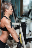 Woman Workout In The Gym — Zdjęcie stockowe