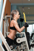 Woman Workout In The Gym — Stock Photo