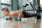 Young Woman Exercising Push Ups — Stock Photo