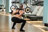 Woman Doing Squats — Stock Photo