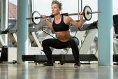 Woman Doing Squats — Stock Photo