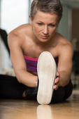 Fitness Woman Stretching On The Floor — Stock fotografie