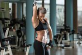 Fitness Women Flexing Muscles In A Healthy Club — Foto de Stock