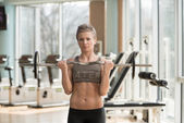 Woman Exercising Biceps With Barbell In Gym — Foto de Stock