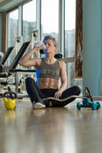 Young Woman Drinking Water After Exercise — Photo