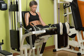 Fitness Woman Exercising Her Legs On Machine — Stock Photo