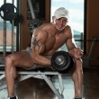 Bodybuilder Exercising Biceps With Dumbbells — Stock Photo