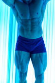 Bodybuilder In Solarium — Stock Photo