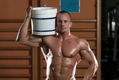 Bodybuilder Posing With Supplements For Copy Space — Stock Photo