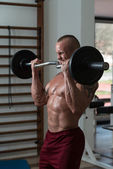 Young Man Exercise With Barbell — Stock Photo