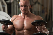 Young Man Exercise With Dumbbells — Stock Photo