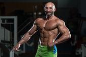 Mature Muscular Man Flexing Muscles — Stock Photo