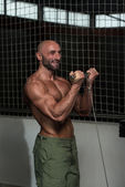 Mature Bodybuilder Exercising Biceps — Stock Photo