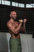 Mature Bodybuilder Exercising Biceps — Stock Photo