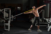 Side view Of Muscular Bodybuilder Throwing Javelin — Stock Photo