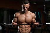 Young Man Doing Exercise For Biceps — Stock Photo