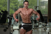 Serious BodyBuilder Standing In The Gym — Stock Photo