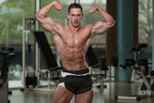 Muscular Men Is Hitting Rear Double Bicep Pose — Stock Photo