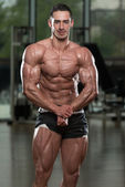 Handsome Body Builder Making Most Muscular Pose — Stock Photo