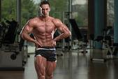 Muscular Men Flexing Muscles — Stock Photo