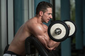 Muscular Men Doing Heavy Weight Exercise For Biceps — Stock Photo