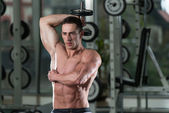 Bodybuilder Exercising Triceps With Dumbbells — Foto de Stock