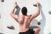 Young Man Climbing A Rock Wall — Stock Photo