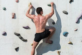 Struggling To Reach Handhold On Climbing Wall — Stock Photo