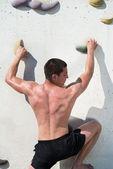 Young Man Climbing A Rock Wall — Stock Photo