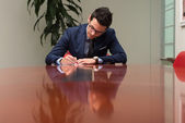 Businessman Sitting At Office Desk Signing A Contract — Stock Photo